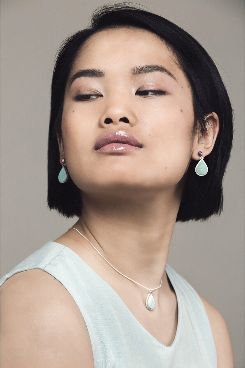 model wearing matching mint green Candide teardrop studs and necklace by Bijoux Pépine Montréal