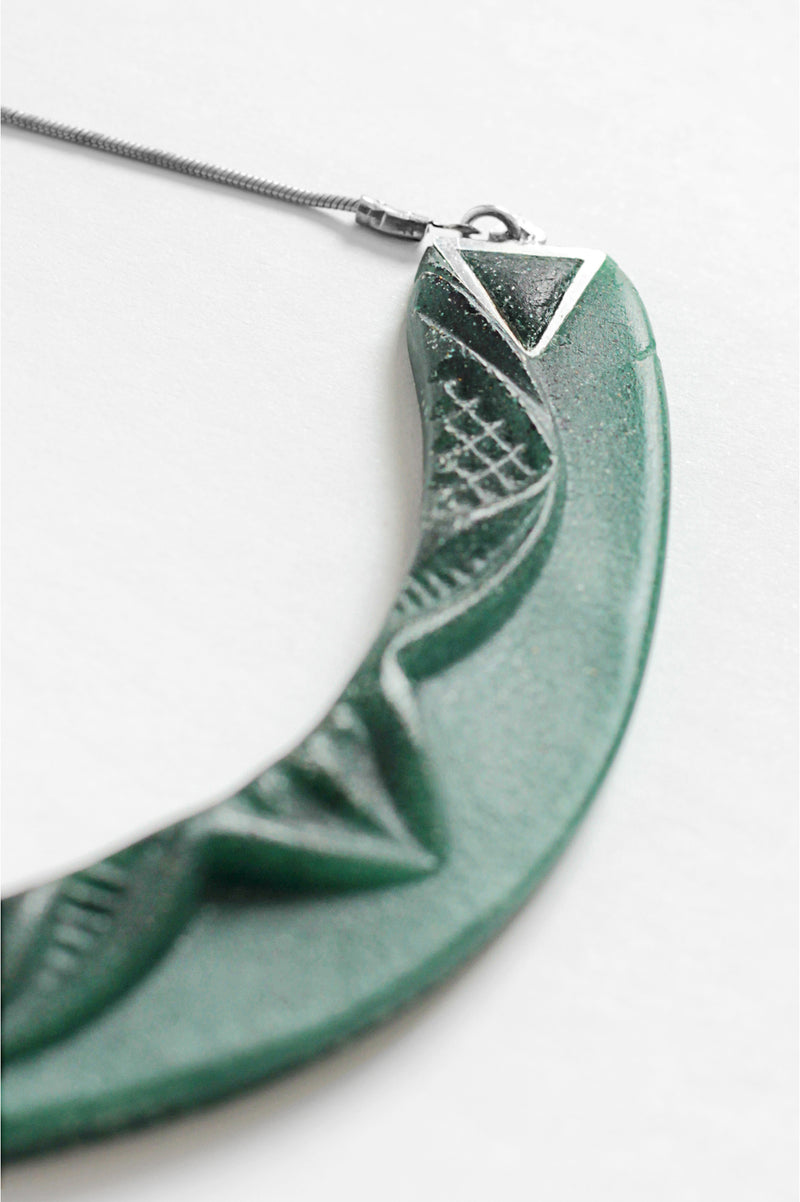 close-up of Couronne, handmade necklace in forest green resin and hypoallergenic stainless steel