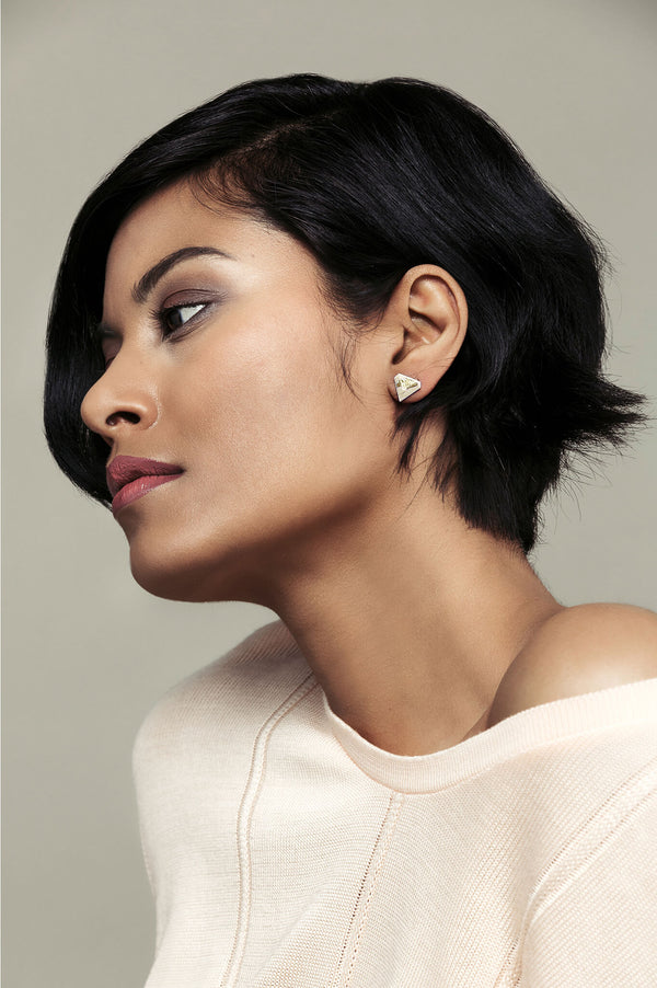 model wearing Montreal designer Bijoux Pépine's beige resin and gold leaf Diamant earrings