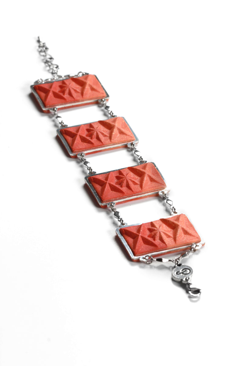 fashion flat lay of Bijoux Pépine's Dihya, luxury bracelet and necklace in red coral resin and hypoallergenic stainless steel
