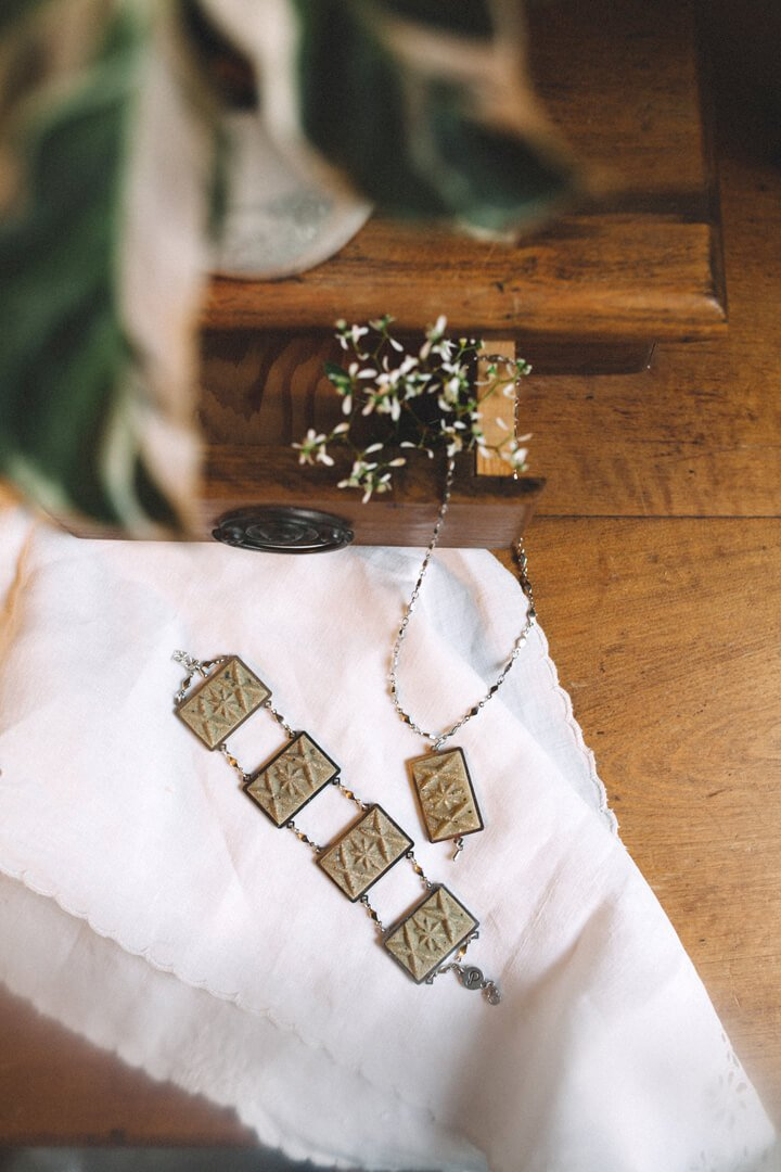 fashion flat lay of Bijoux Pépine's Dihya, luxury bracelet and necklace in matcha green resin and hypoallergenic stainless steel