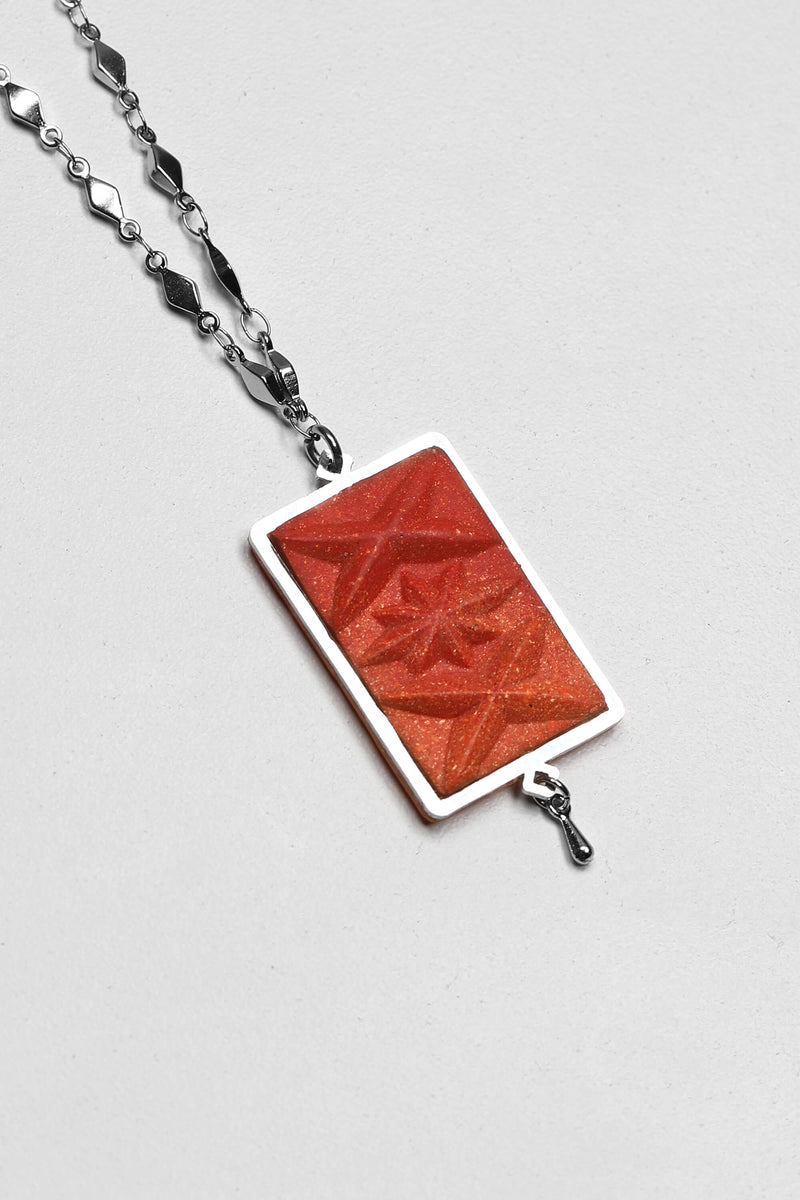 Bijojux Pépine's Dihya, handmade luxury necklace in coral red resin and hypoallergenic stainless steel