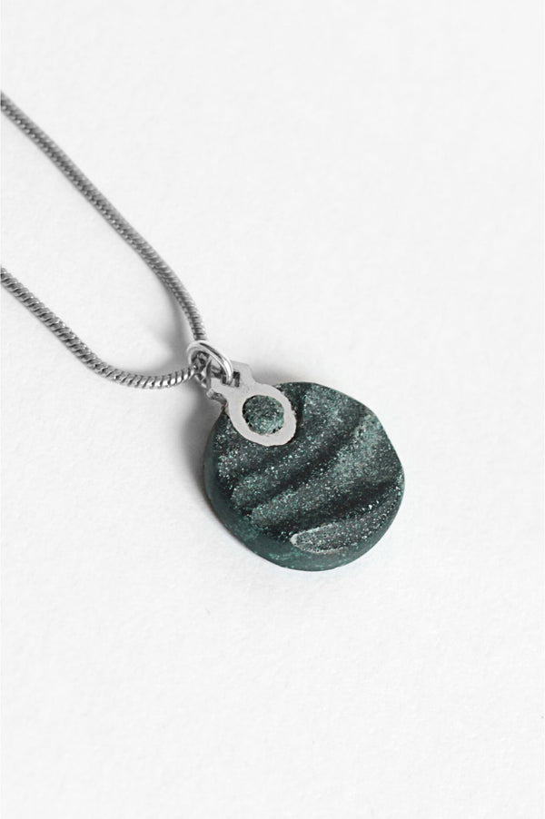 close-up of Dune, handmade necklace in two-toned forest green resin and hypoallergenic stainless steel