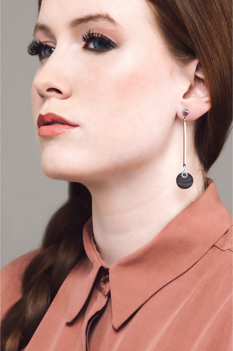 model wearing Montreal handmade Dune earrings in burgundy red by Bijoux Pépine