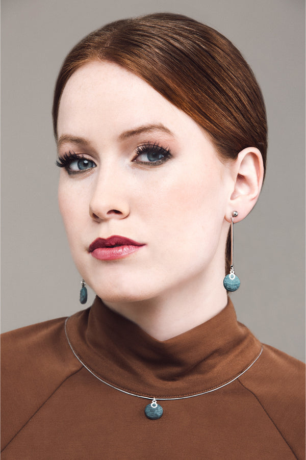 model wearing Montreal handmade Dune earrings and necklace in two-toned forest green by Bijoux Pépine