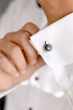 male model wearing handmade Echo cufflinks in marbled black and white resin and stainless steel
