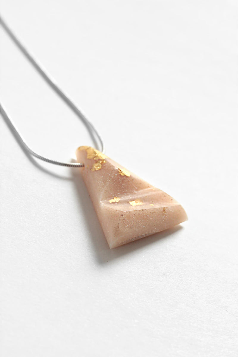 Eclat, triangular pendant necklace resin in beige, gold leaf and hypoallergenic stainless steel