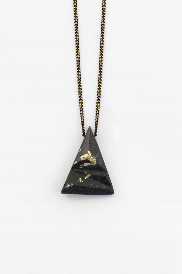 Eclat, unisex triangular pendant necklace in black resin, gold leaf and blackened brass chain