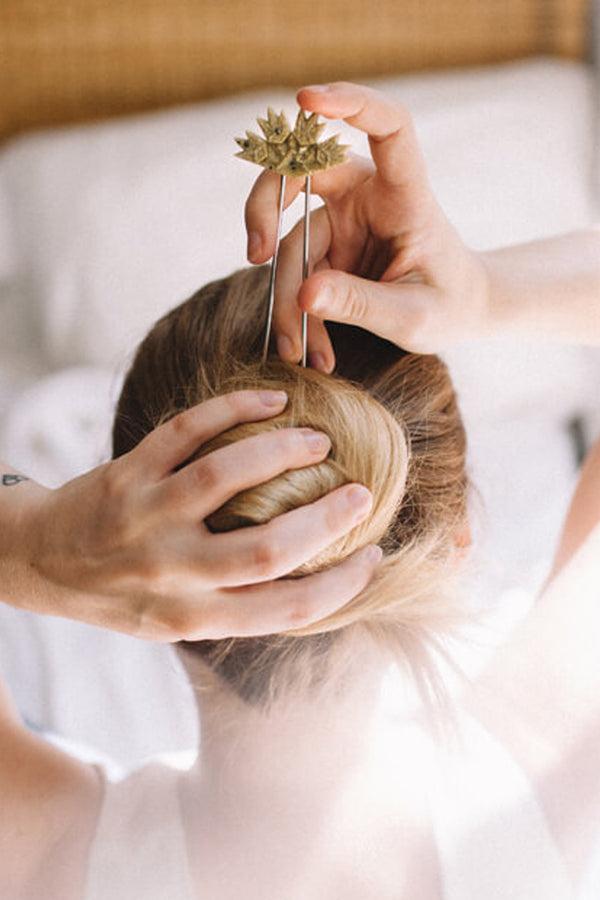 woman wearing a bun using Bijoux Pépine's handmade hairpin Flabellum in matcha green