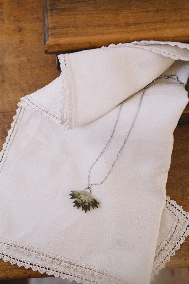 flat lay of Bijoux Pépine's Flabellum, luxury pendant necklace for her in matcha green