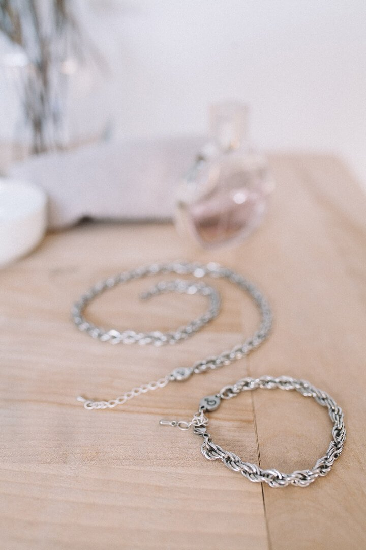 Montreal designer Bijoux Pépine's high fashion stainless steel signature chain bracelet and matching necklace