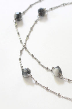Hasard, handmade luxury necklace in marbled black and white resin and hypoallergenic stainless steel