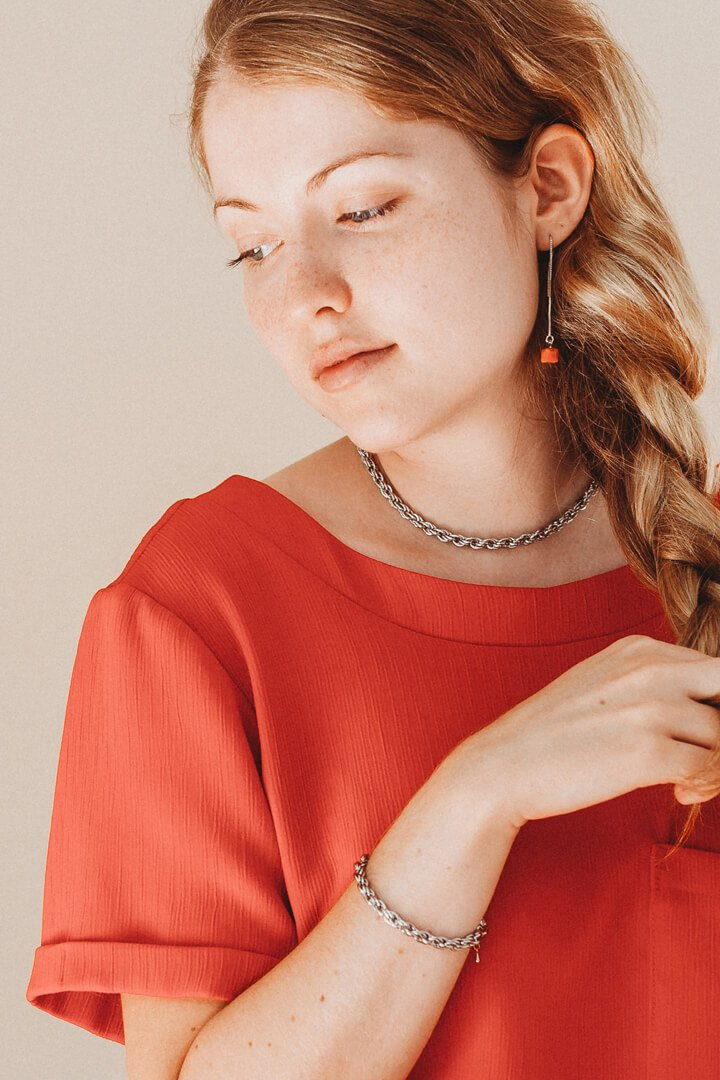 blonde fashion model wearing coral red Hasard earrings
