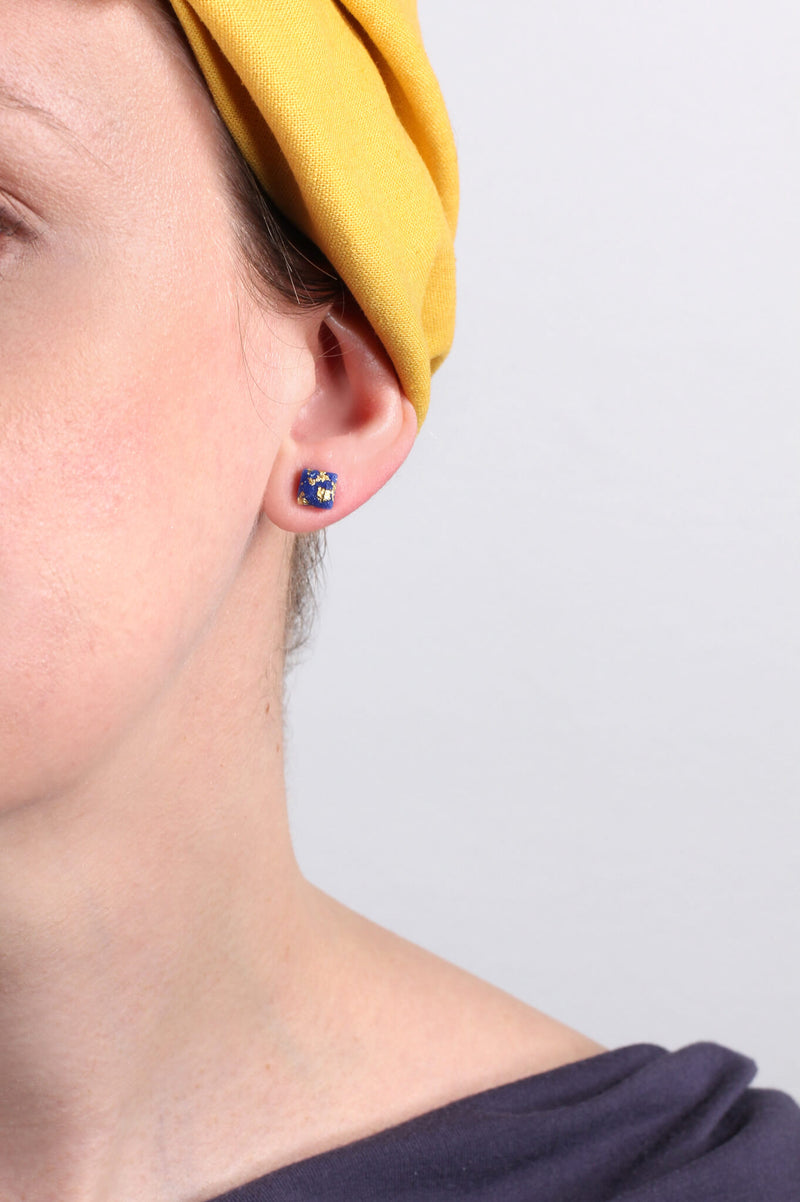 model wearing handmade classic blue Mozaique earrings with gold leaf