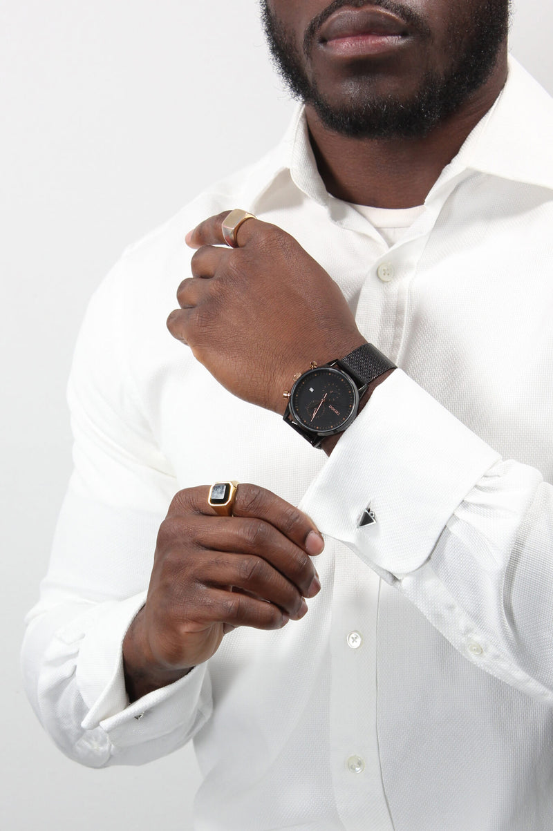 male model in business attire wearing Bijoux Pépine's Echo, handmade triangular cufflinks in black