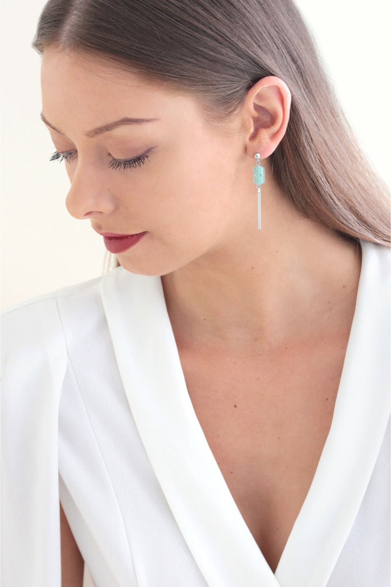model wearing Bijoux Pépine's handmade Nova stud earrings in mint green