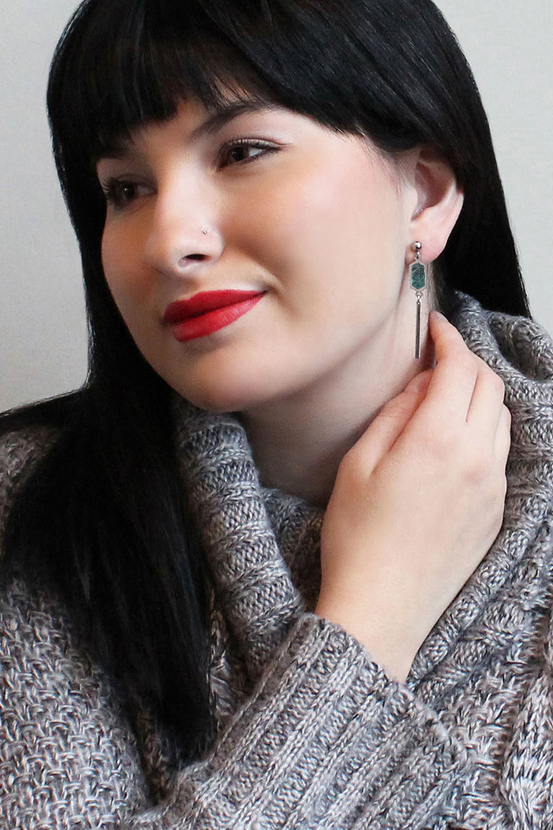 black-haired model wearing Bijoux Pépine's handmade Nova stud earrings in forest green