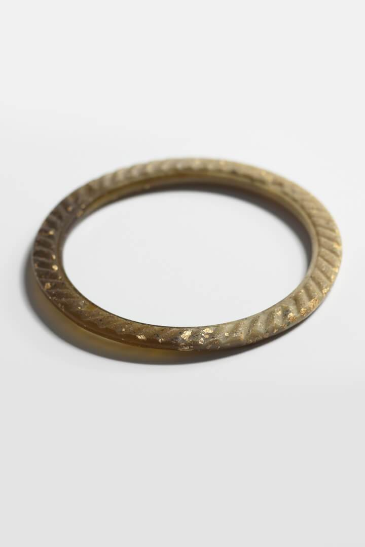 Ouroboros, Bijoux Pépine's handmade bangle bracelet in two-toned matcha green resin and 24 karat gold leaf