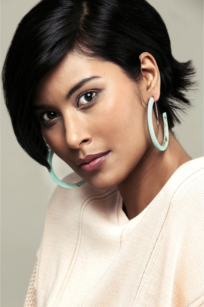 fashion model wearing Bijoux Pépine's handmade Ouroboros hoops in mint green