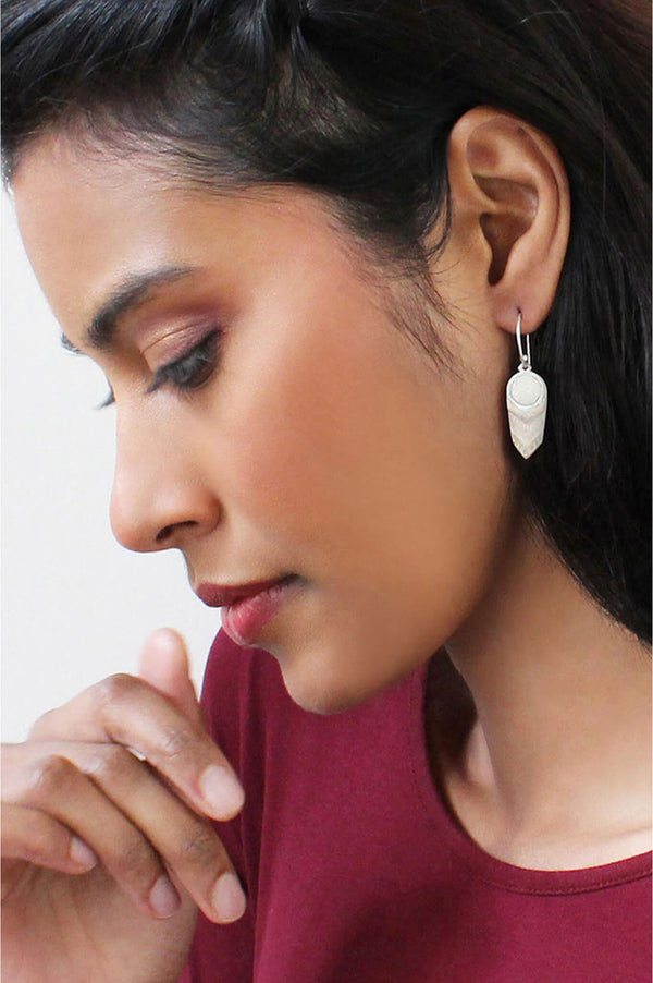model wearing Panache earrings handmade with beige resin and hypoallergenic stainless steel