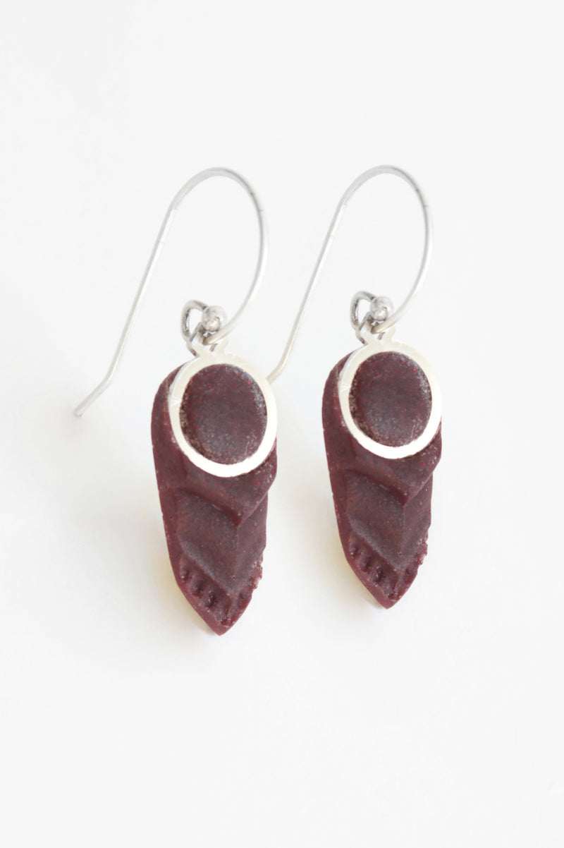 Panache, feather-shaped earrings handmade in Montreal with burgundy red resin and hypoallergenic stainless steel