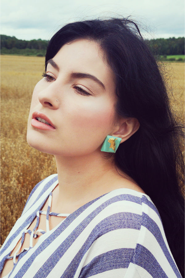model wearing Bijoux Pépine's mint green and gold leaf Parfait studs