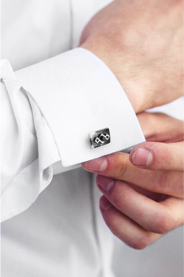 male model wearing Bijoux Pépine's Pineale geometric cufflinks in marbled black and white