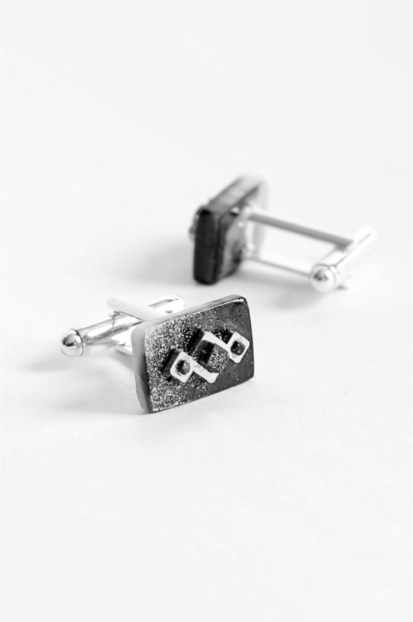 Pineale, geometric cufflinks handmade in Montreal with marbled black and white resin and hypoallergenic stainless steel