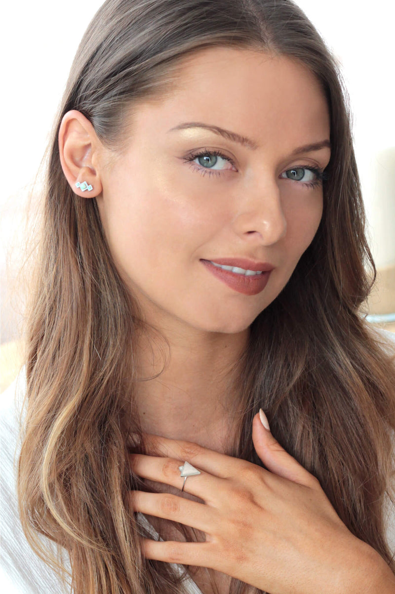 fashion model wearing Canadian brand Bijoux Pépine's Pinéale studs in mint green
