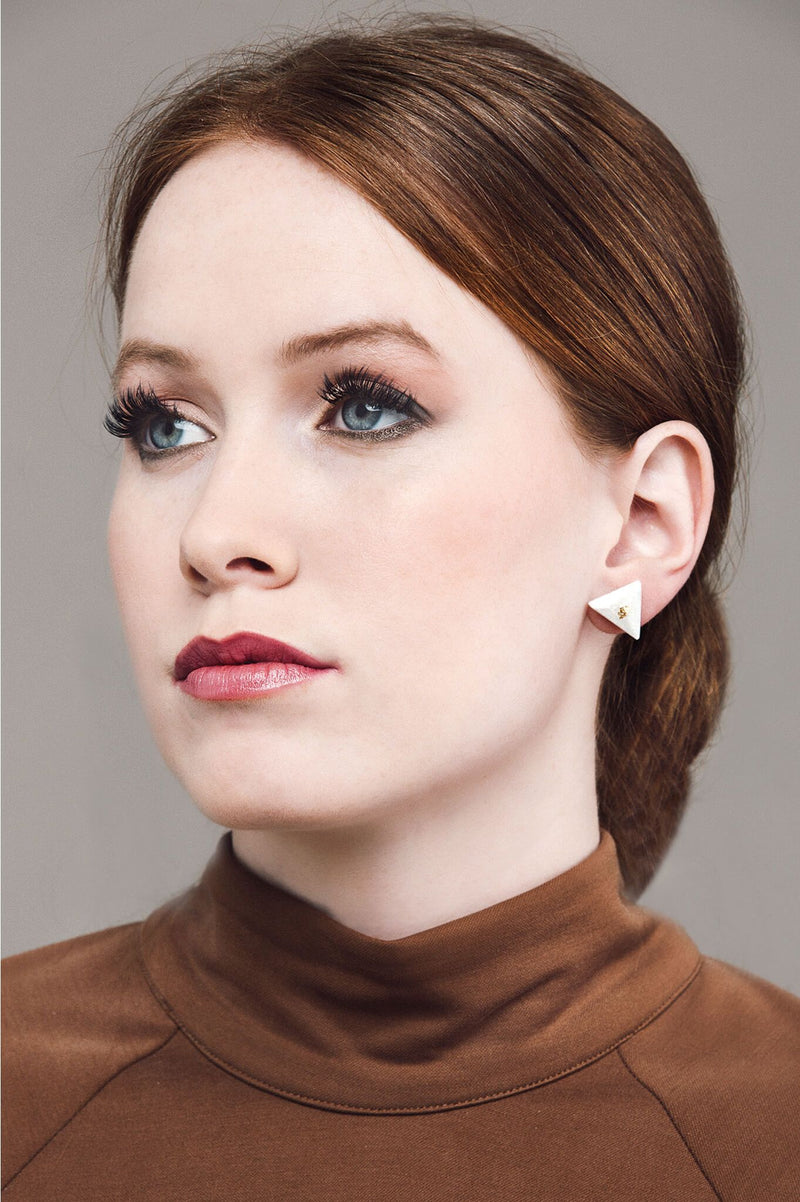 fashion model wearing Bijoux Pépine's hypoallergenic Pyramide studs in beige