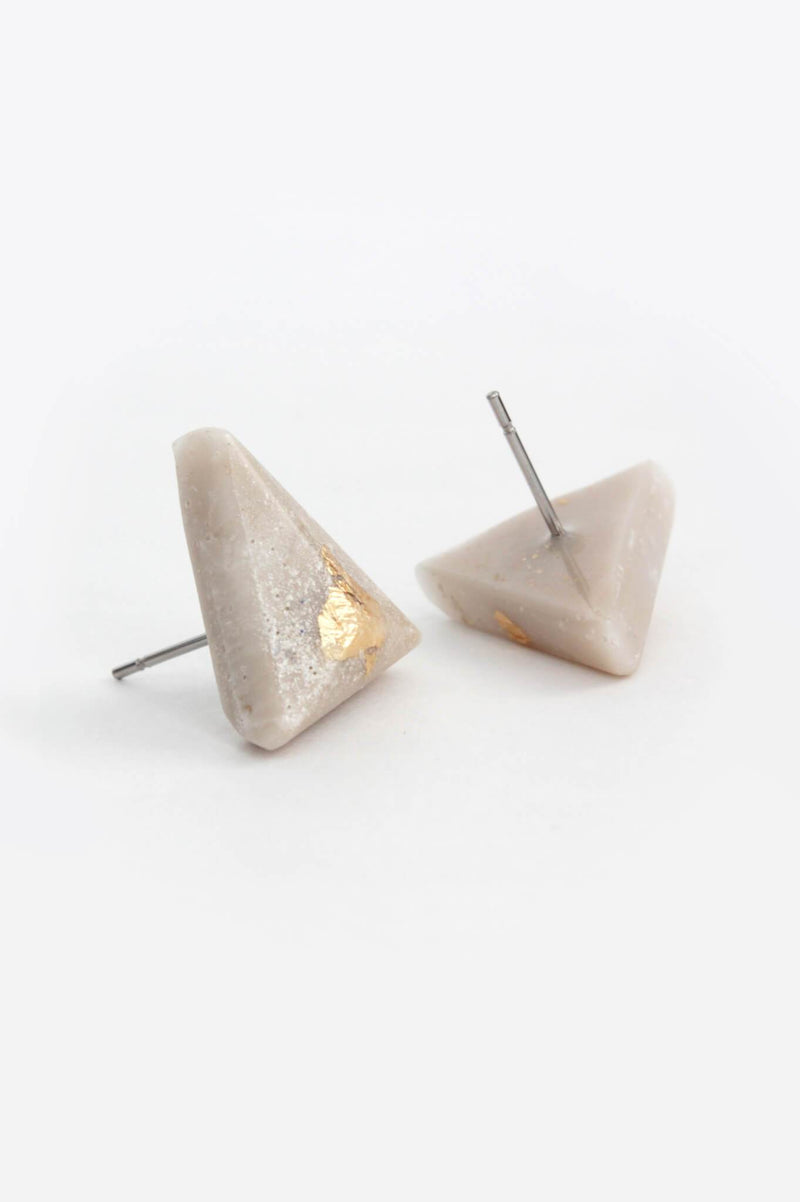 Pyramide, medium-sized triangular studs handmade in Montreal with beige resin and gold leaf
