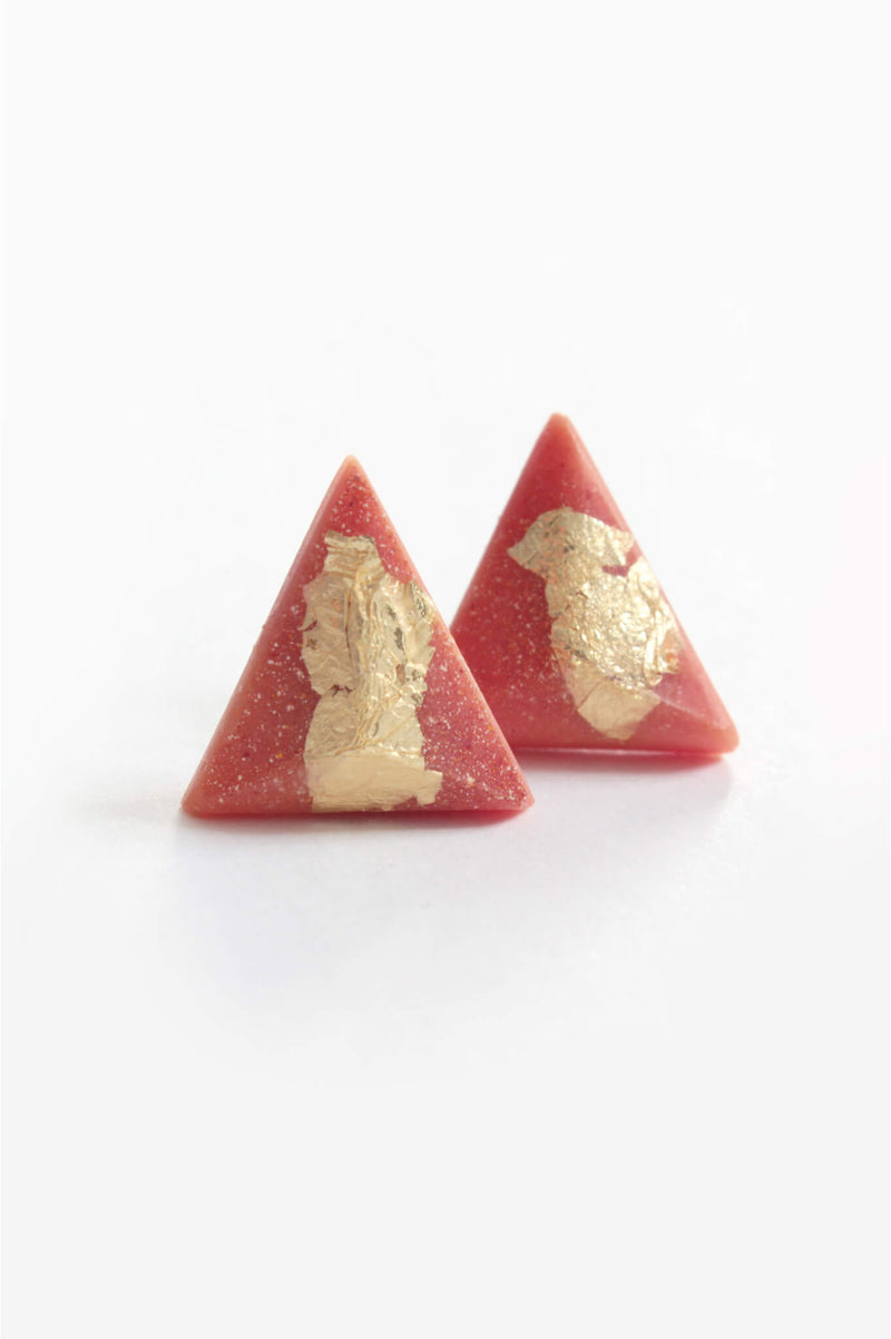 Pyramide, medium-sized triangular studs handmade in Montreal with coral red resin and gold leaf