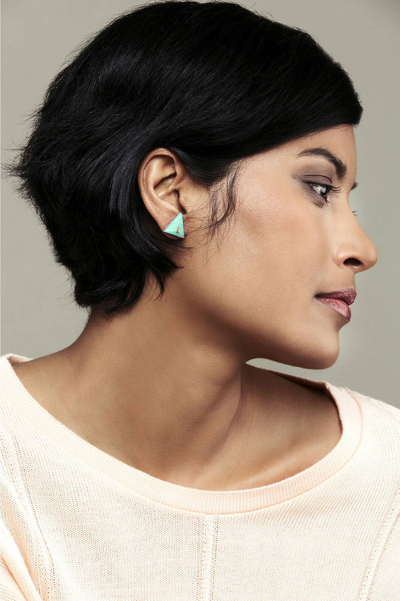 fashion model wearing Bijoux Pépine's hypoallergenic Pyramide studs in mint green