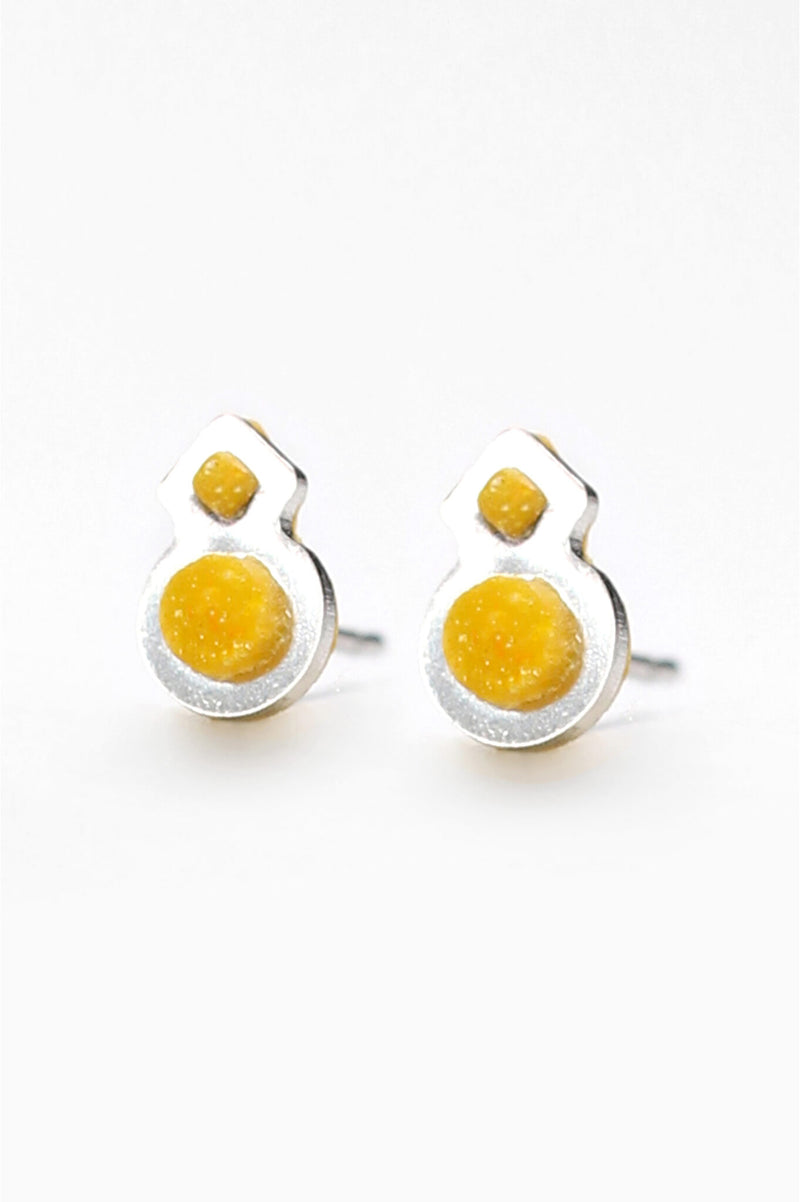 Rose des Vents, small studs handmade in Montreal with golden ochre yellow resin and hypoallergenic stainless steel