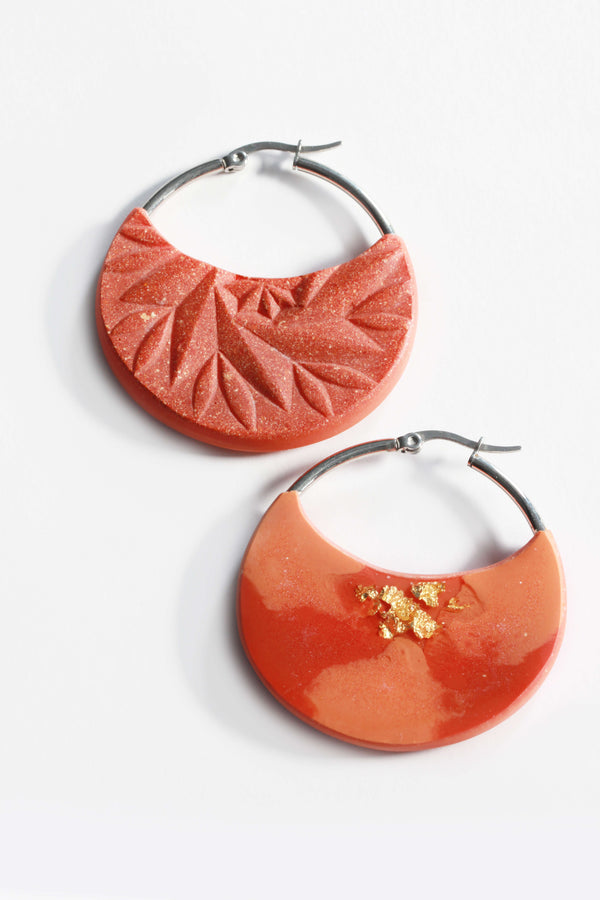 Séléné, coral red resin and 24 karat gold leaf luxury hoop earrings handmade in Montreal by Bijoux Pépine