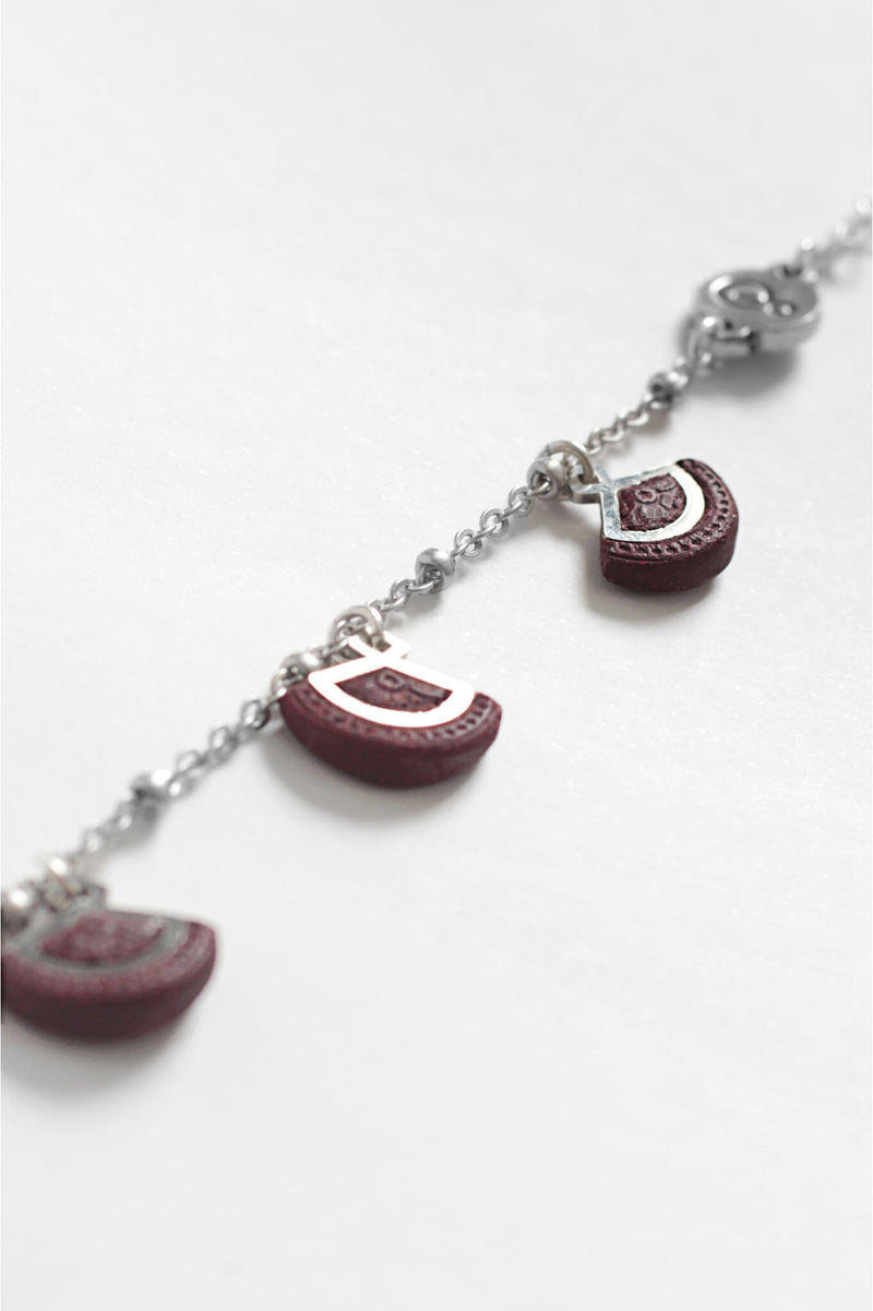 St-Jacques, luxury charms bracelet handmade in Canada with hypoallergenic stainless steel and burgundy red resin