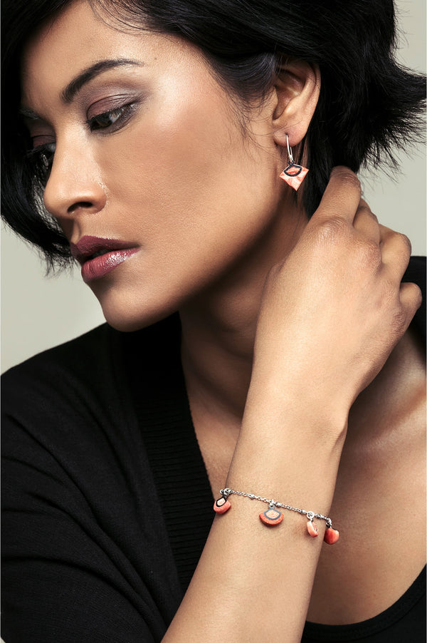female model wearing St-Jacques luxury bracelet in coral red, handmade in Canada by Bijoux Pépine Montreal