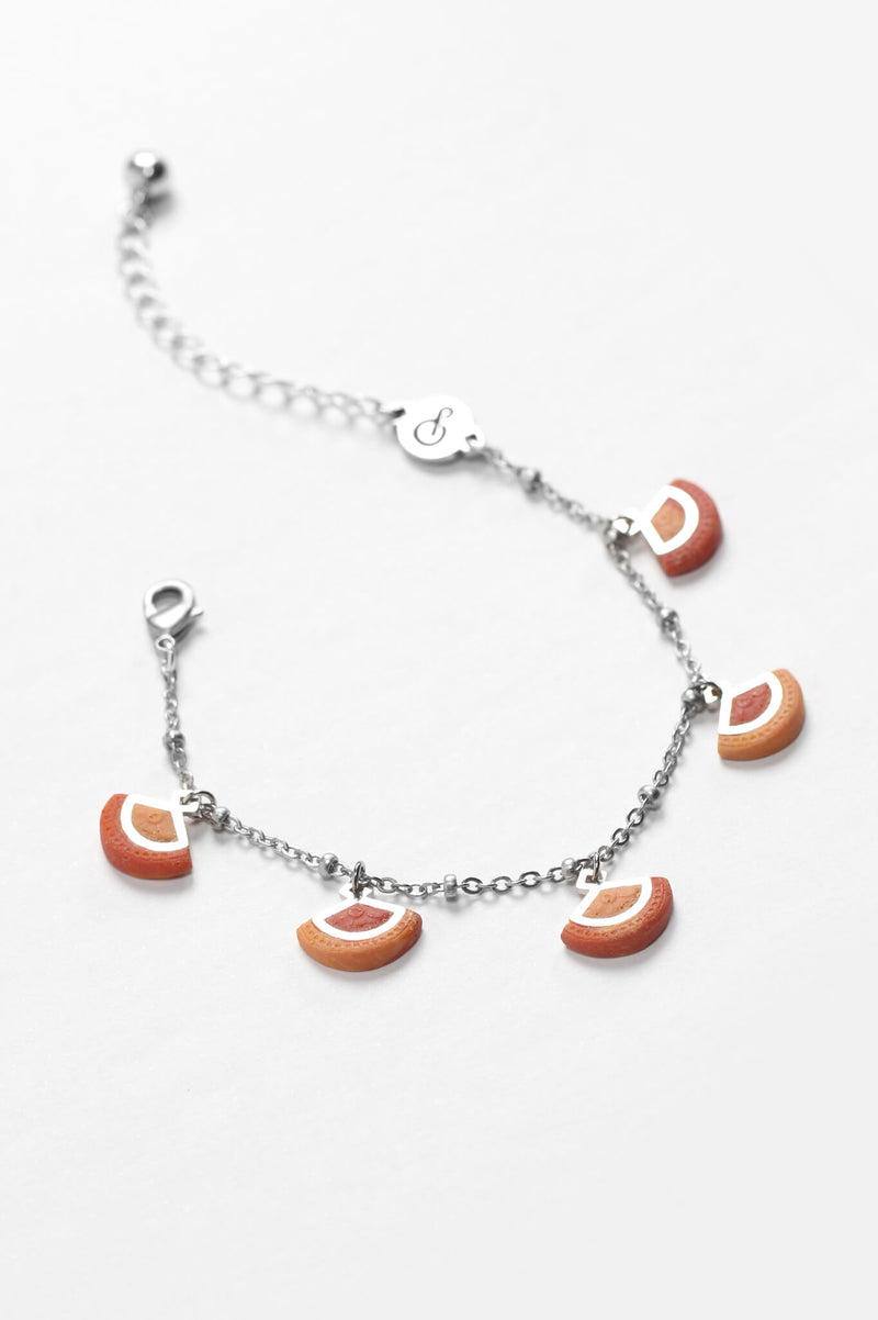 St-Jacques, luxury charms bracelet handmade in Canada with hypoallergenic stainless steel and coral red resin
