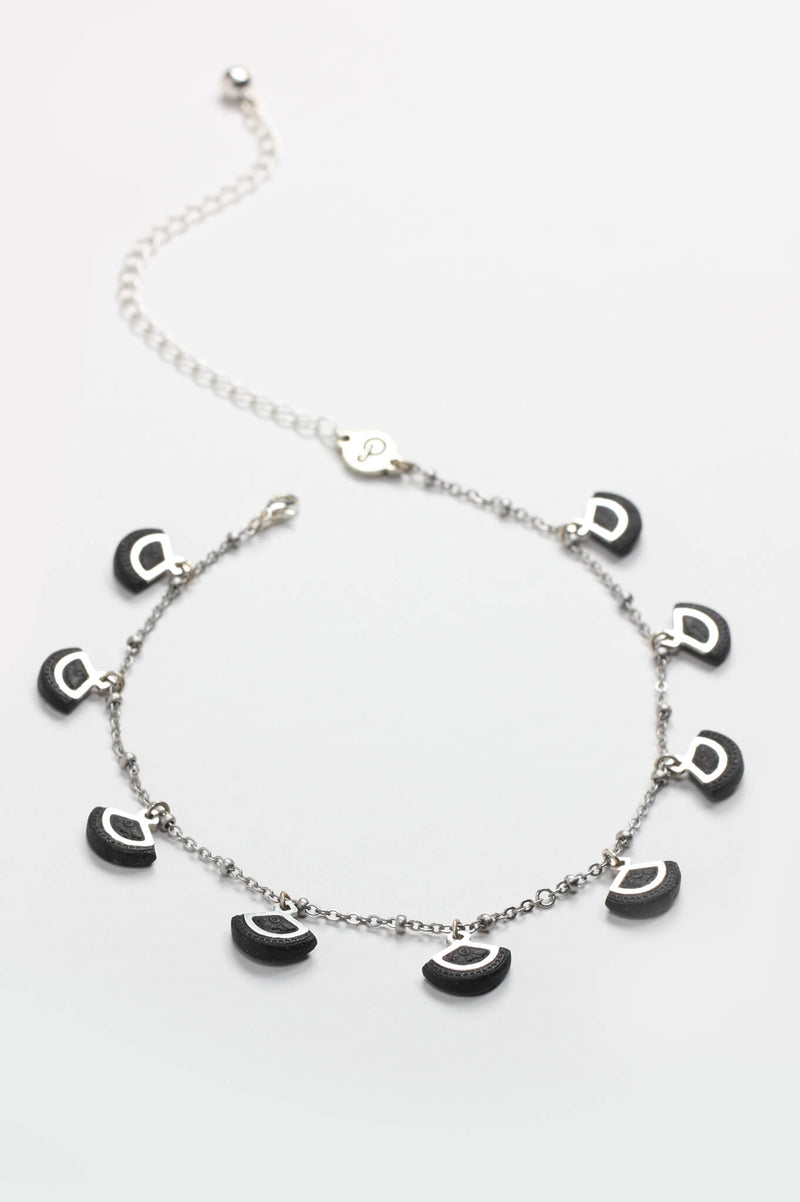St-Jacques, luxury charms necklace handmade in Montreal with hypoallergenic stainless steel and black-colored resin