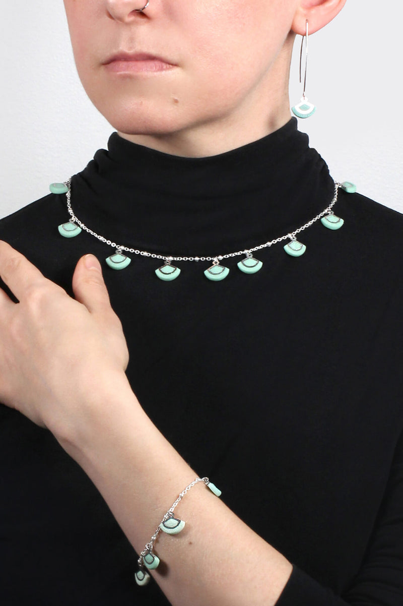 model wearing St-Jacques mint green necklace and matching bracelet and earrings