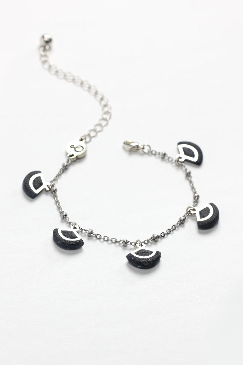 St-Jacques, luxury charms bracelet handmade in Canada with hypoallergenic stainless steel and black resin