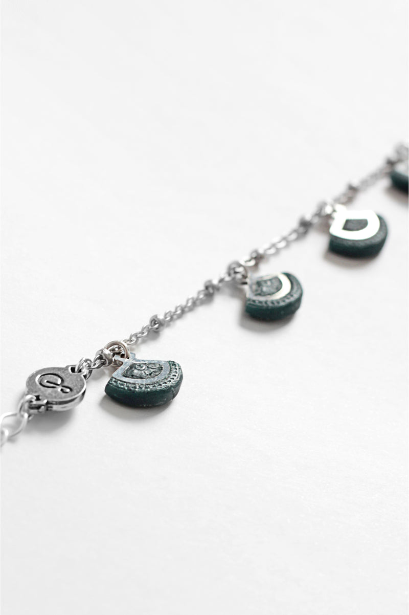 St-Jacques, luxury charms bracelet handmade in Canada with hypoallergenic stainless steel and forest green resin