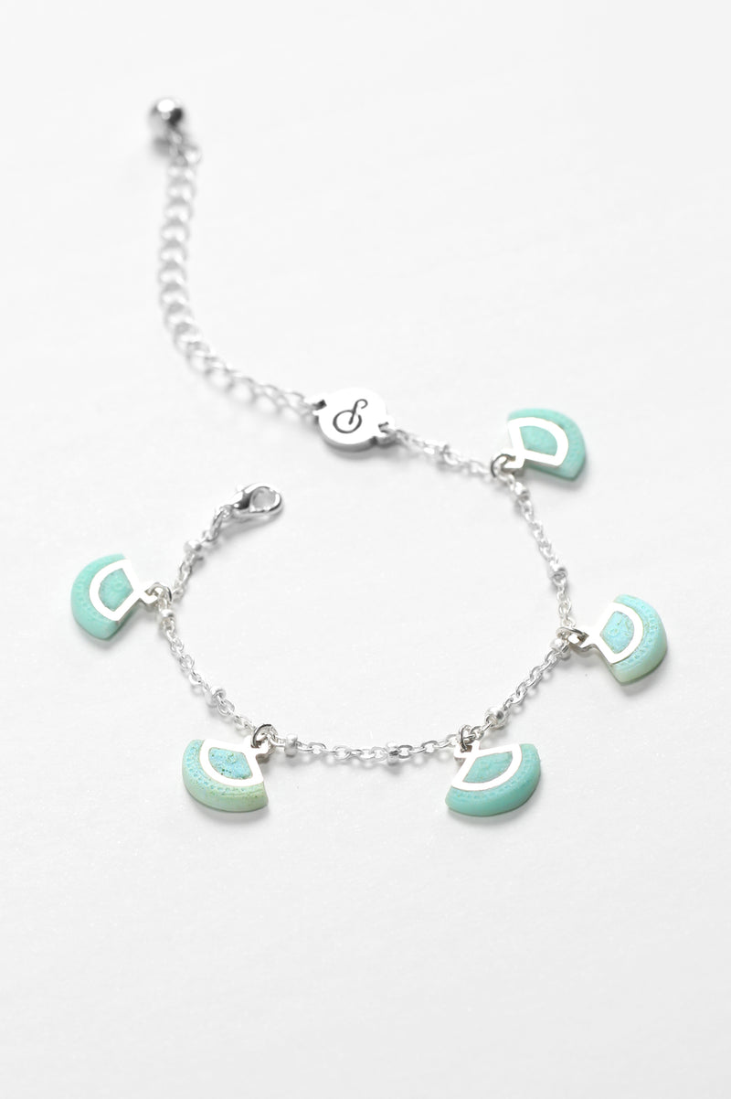 St-Jacques, luxury charms bracelet handmade in Canada with hypoallergenic stainless steel and mint green resin