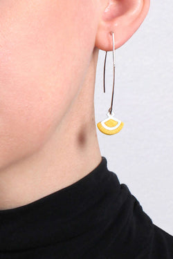 St-Jacques, light shell-shaped earrings handmade in Montreal with yellow ochre resin and hypoallergenic stainless steel