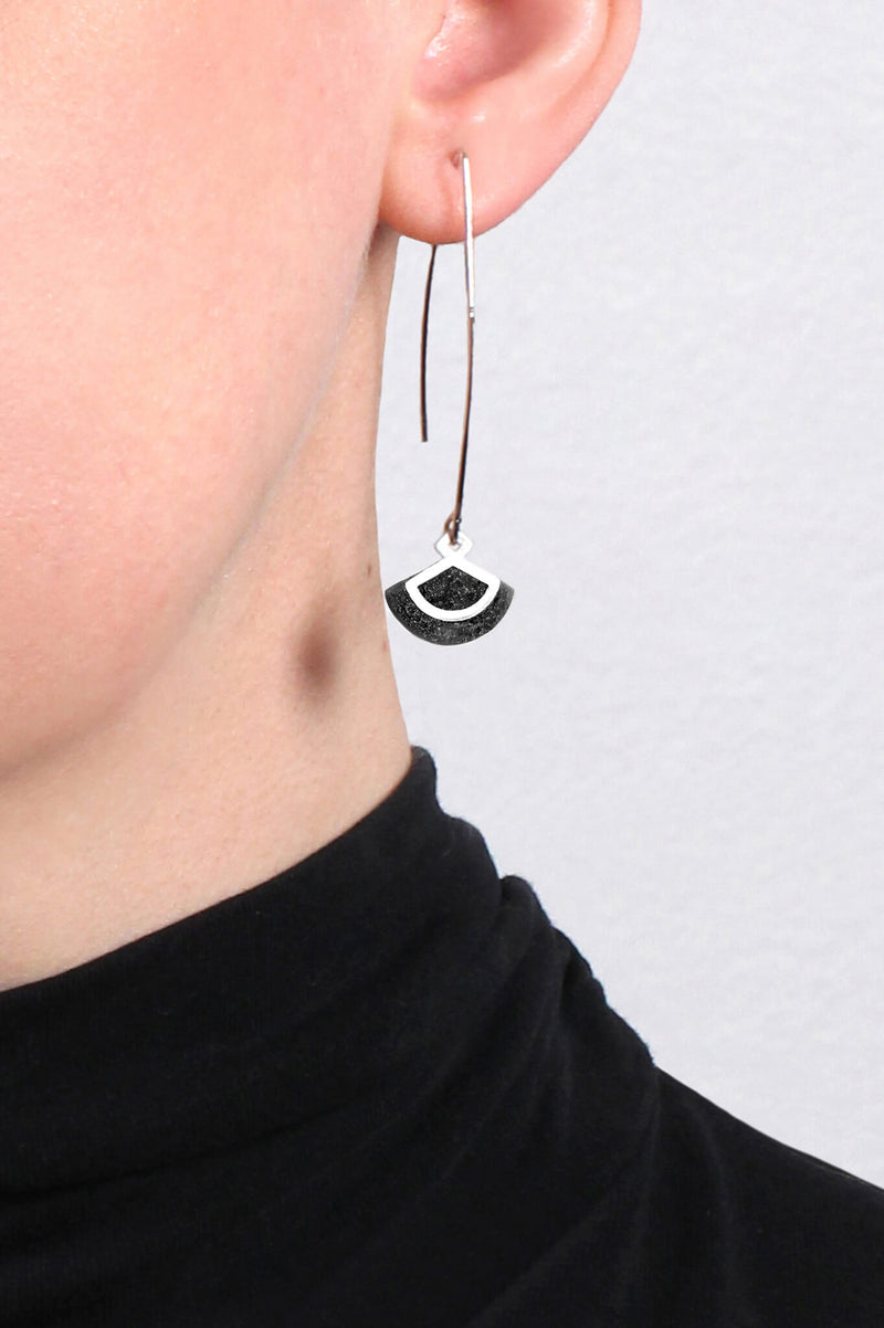 model wearing St-Jacques hypoallergenic handmade earrings in black