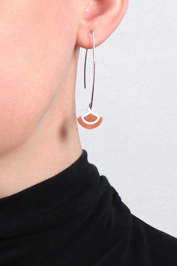 model wearing St-Jacques hypoallergenic handmade earrings in coral