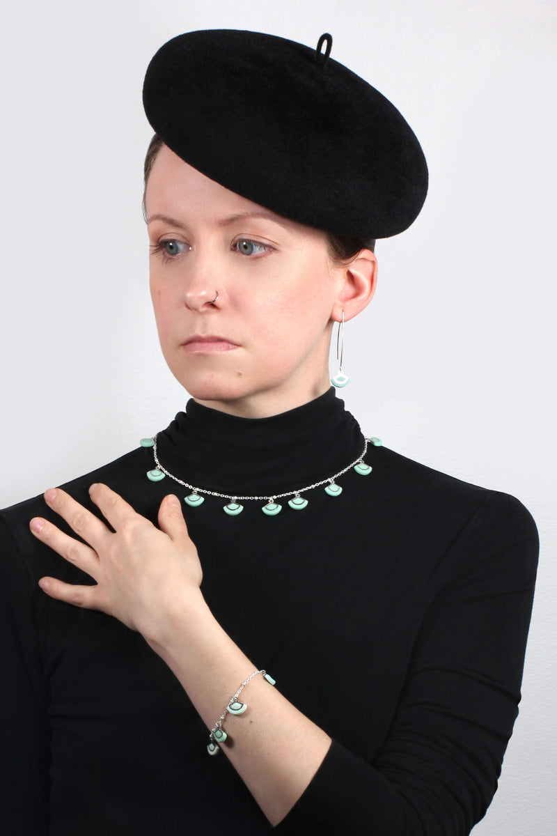 model wearing mint green St-Jacques hypoallergenic handmade earrings and matching bracelet and necklace