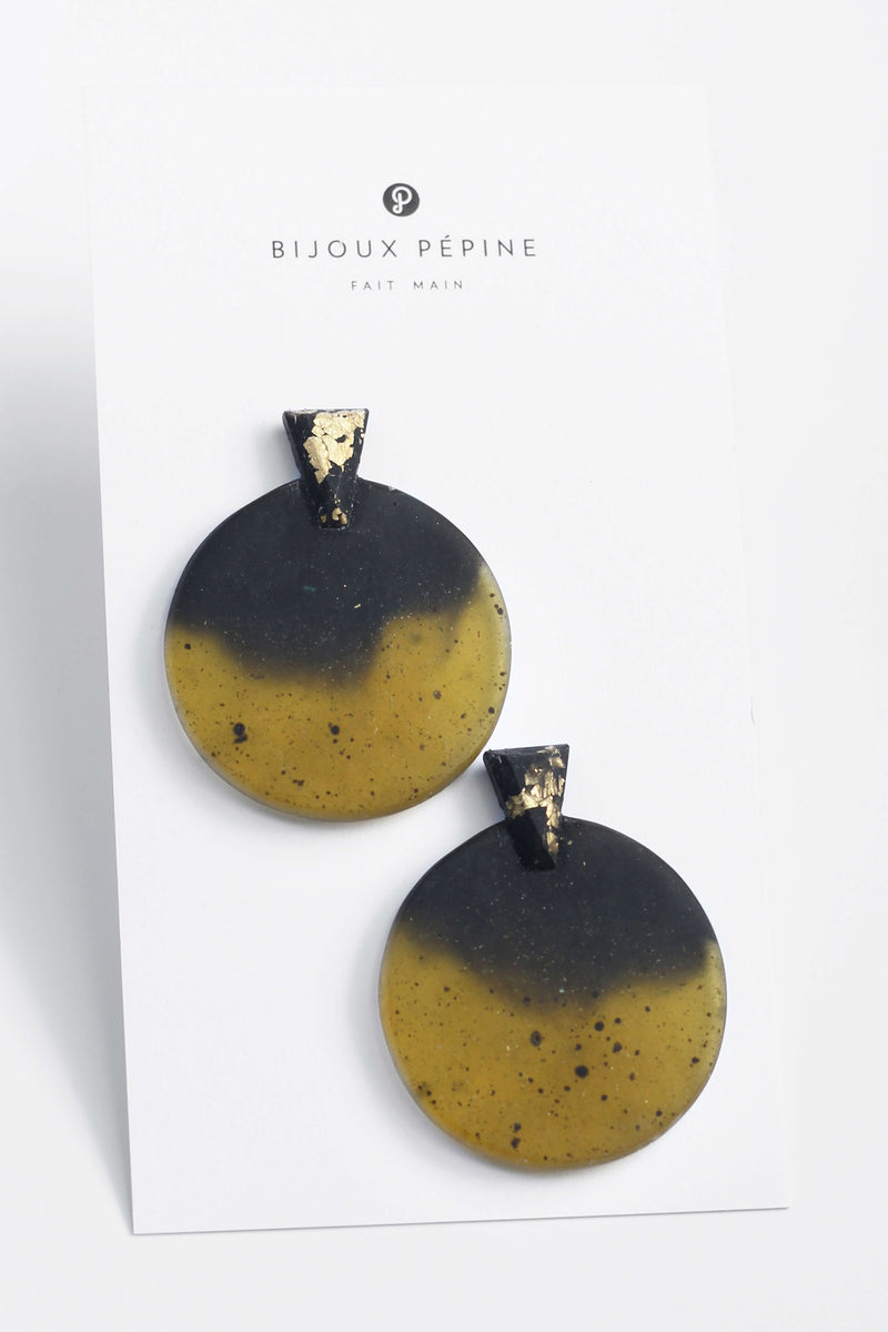 Ulu, contemporary statement studs in black and translucent matcha green resin and gold leaf