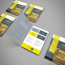 Load image into Gallery viewer, Picture of a Brochure flat showing the way it folds, other folded brochures on the table
