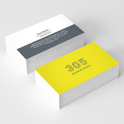 Picture of two stacks of business cards showing the front and the back on each stack